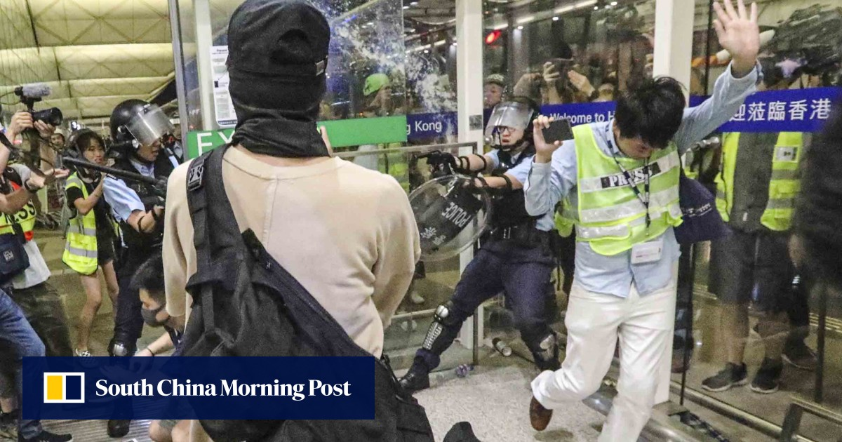 Riot police, protesters clash in unprecedented violence at Hong Kong airport