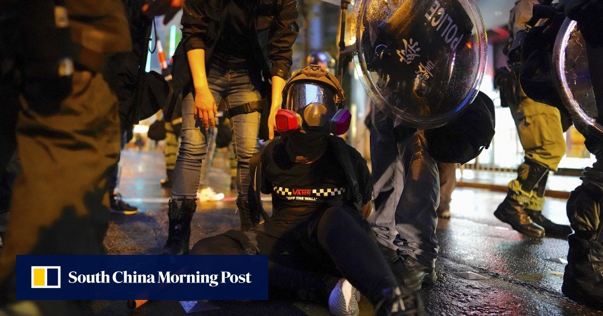 Hong Kong police defend force's detention protocol after