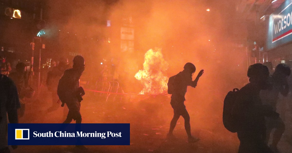 Police battle protesters as they set streets ablaze in central Hong Kong