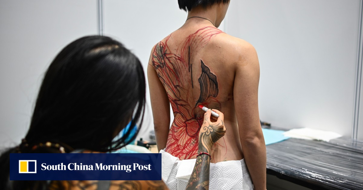 Half-naked parades at Malaysia tattoo show leave