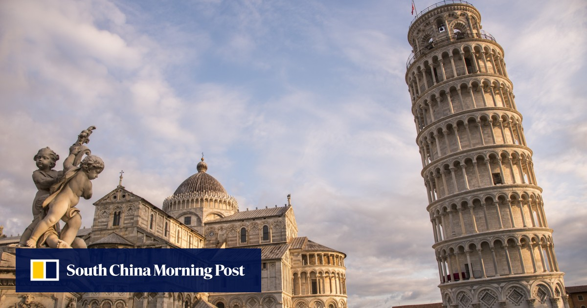At Pisa's Leaning Tower, tourists provide the entertainment