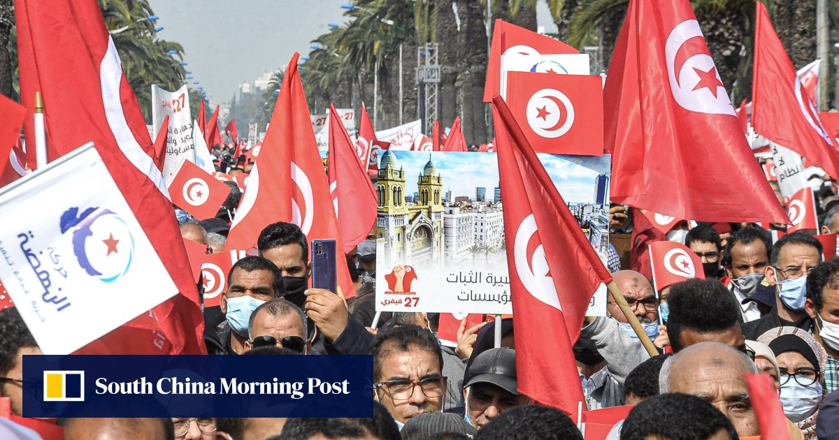 Thousands of protesters march in Tunisia as political crisis deepens