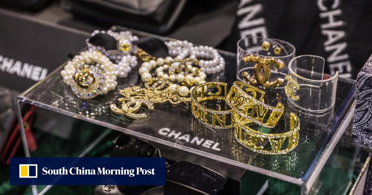 Hong Kong customs arrests 22, closes 17 webpages in fake designer goods bust