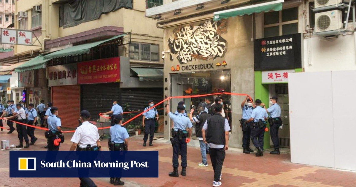 Hong Kong national security police search shop over display evoking banned slogan