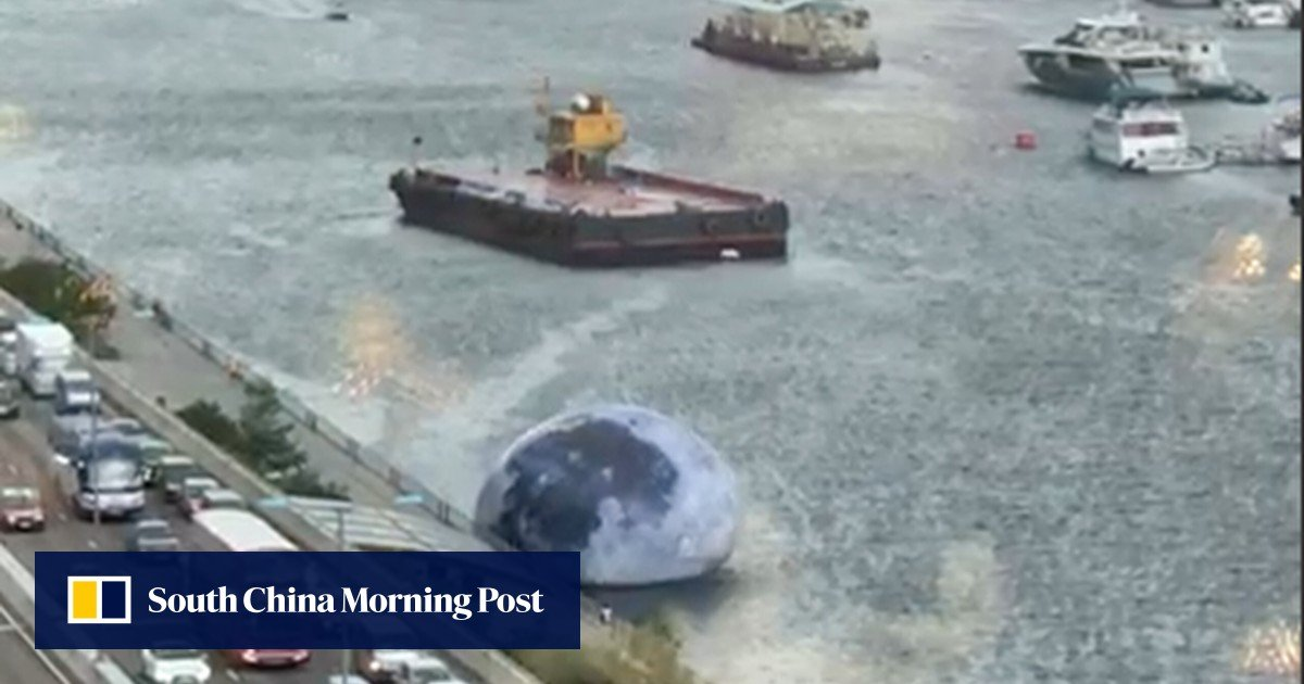 Moon left deflated in sea as high winds and rain batter Hong Kong