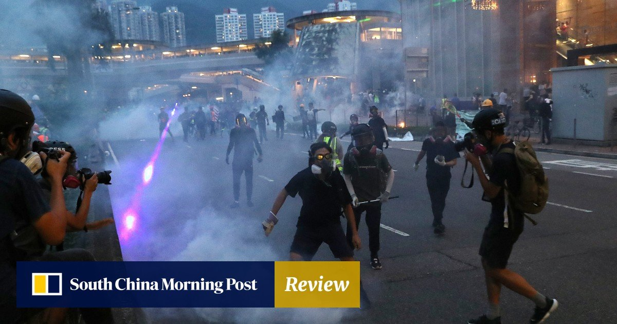New phase as protesters and police clash across Hong Kong in