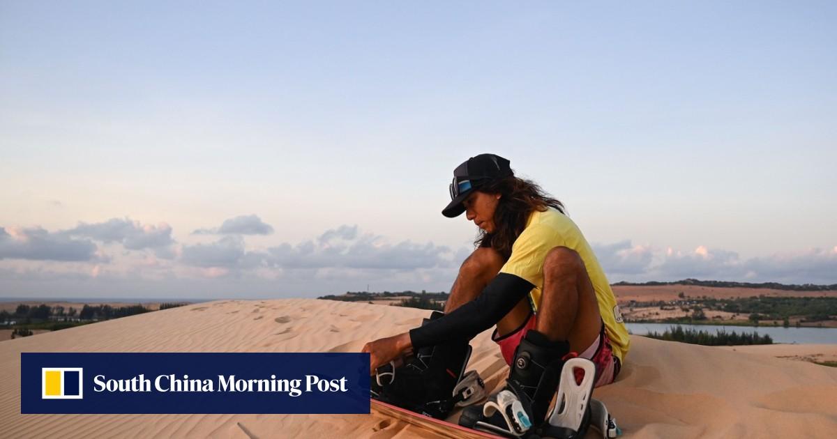 No snow, so Vietnamese snowboarder rides local sand dunes to