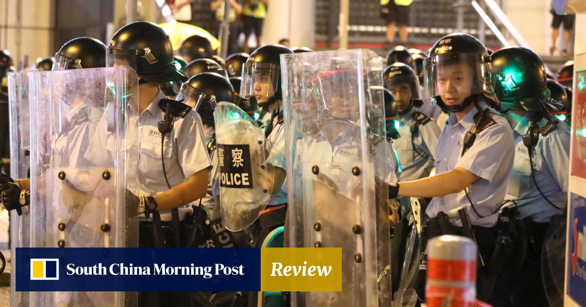 Hong Kong police defend decision to withdraw from posts at two