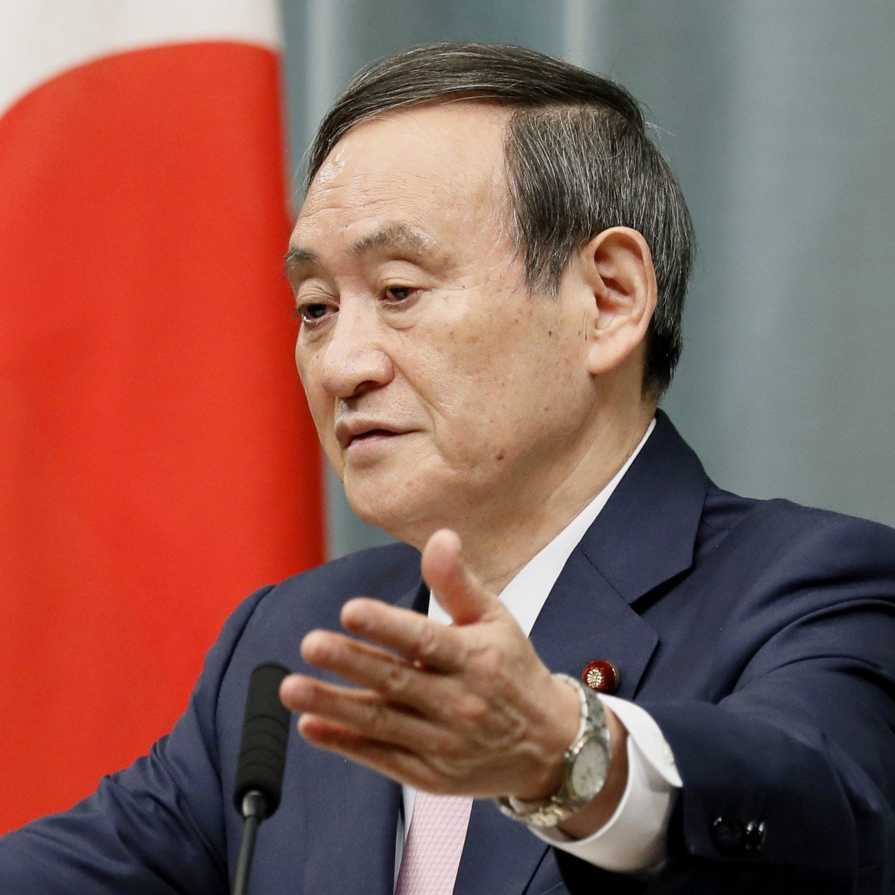 US trip by Japan's chief cabinet secretary Yoshihide Suga sparks