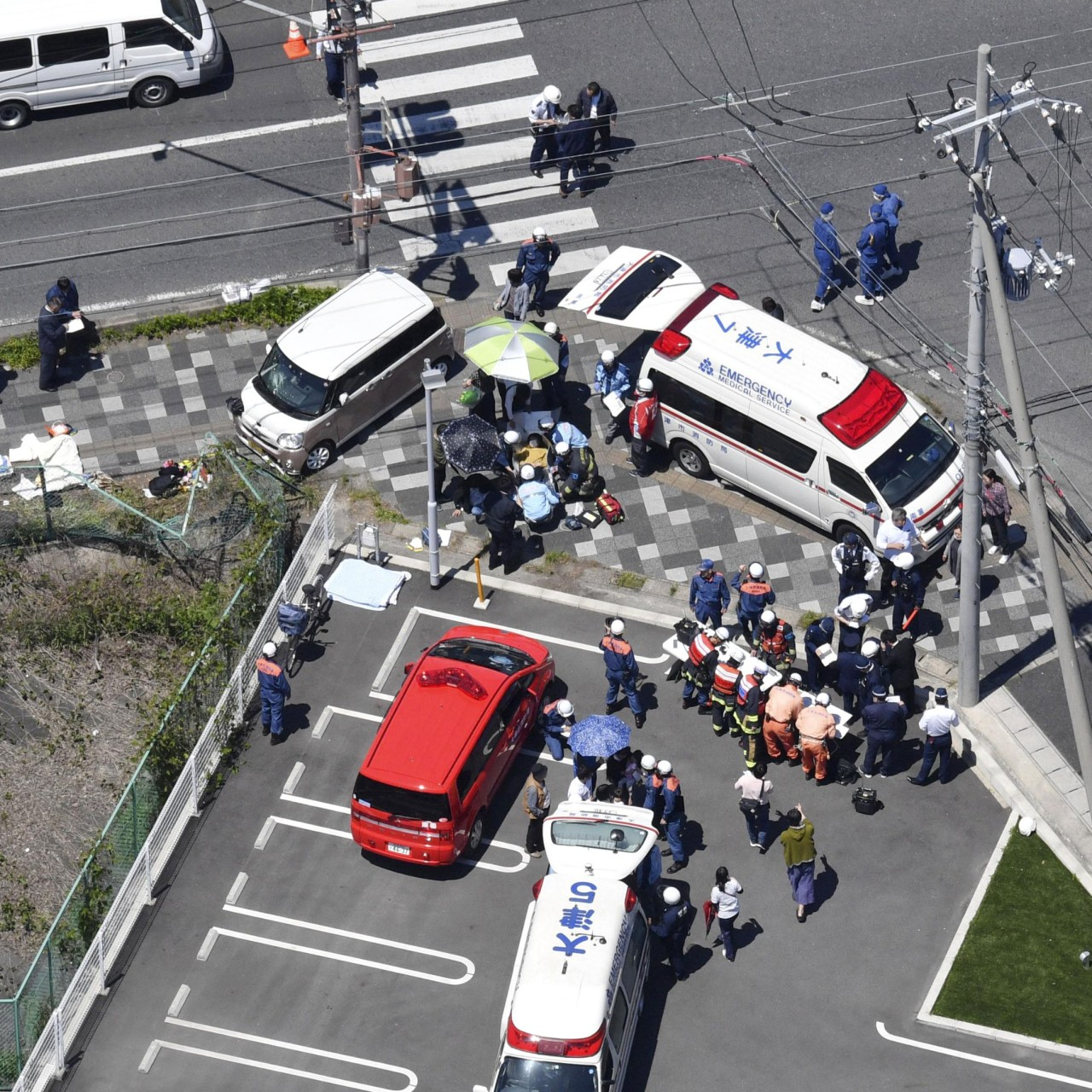 Two children killed after car ploughs into crowd of