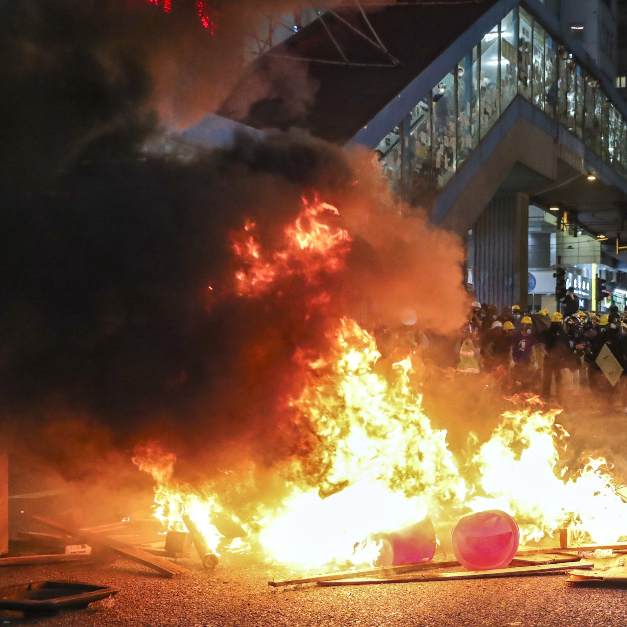 Hong Kong police play catch-up as anti-government protesters wreak