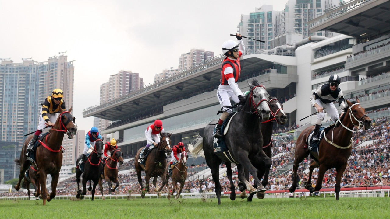 Masami Matsuoka stands and delivers a celebration to remember after winning the QEII Cup at Sha Tin. Photos: Kenneth Chan
