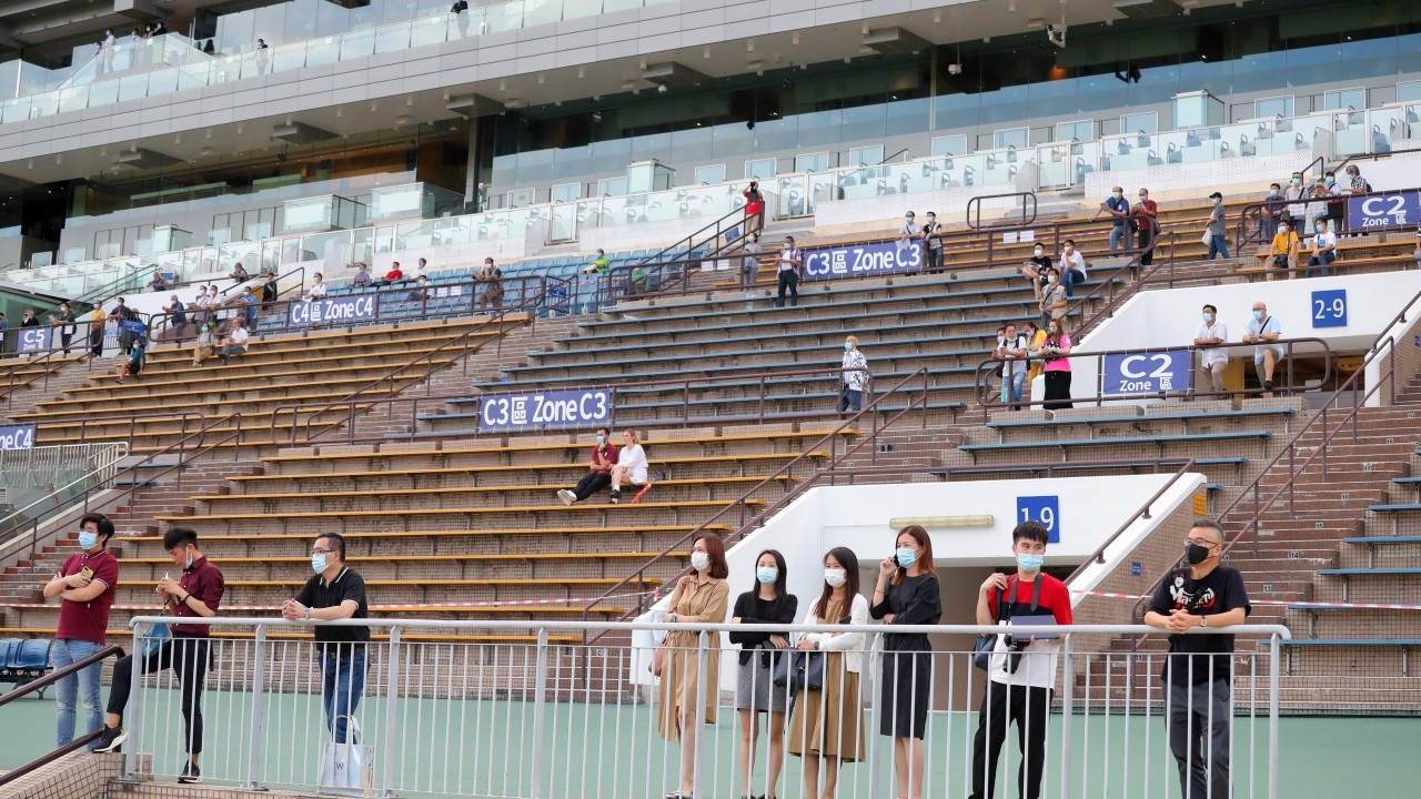 Fans in the stands enjoy the action at Sha Tin on Sunday. Photos: Kenneth Chan