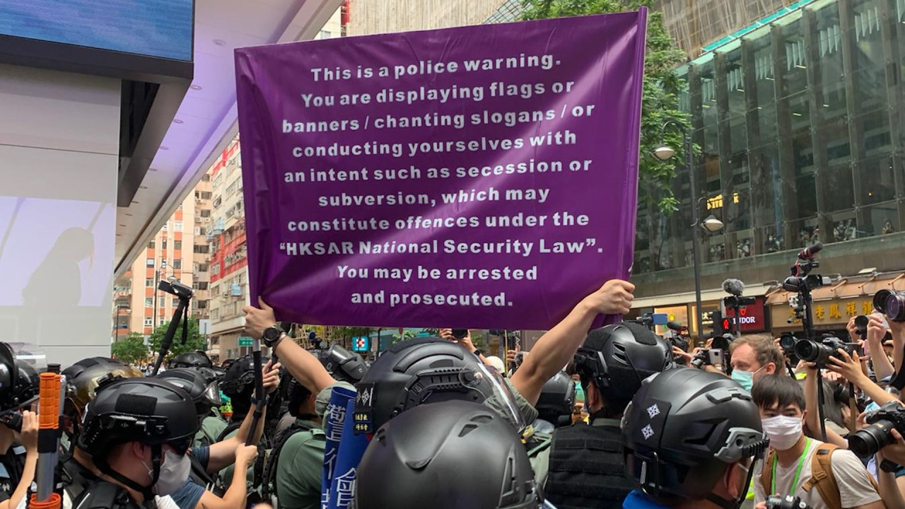 New purple flag warning protesters about breaking national security law used by Hong Kong police