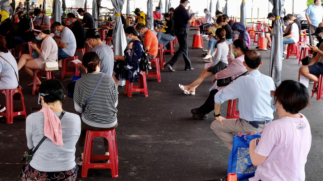 Queues at Taiwan Covid-19 testing site as the island battles surge in cases